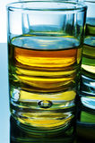 Wisky shots. Closeup of some wisky shots on a reflecting surface Stock Image