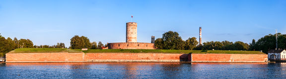 Wisloujscie Fortress in Gdansk, Poland. Medieval Wisloujscie Fortress with old lighthouse tower in port of Gdansk, Poland. A unique monument of the fortification Royalty Free Stock Images