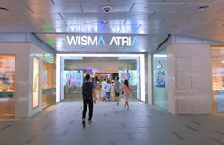 Shopping Orchard road Singapore. People shop at Wisma Atria shopping mall in Orchard Road Stock Images