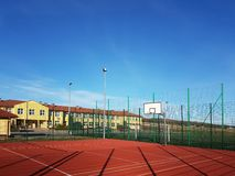 Wisniowa, Poland - 10 17, 2018: Modern basketball court in the courtyard of primary school. Multifunctional children`s playground royalty free stock photos