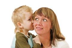 Wisper im moms ear Stock Image