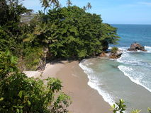 Wispering Waters. Secluded beach on the north coast of Trinidad and Tobago, W.I Stock Photo