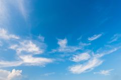 Cirrus Clouds. Wispy cirrus clouds against a blue sky stock photo