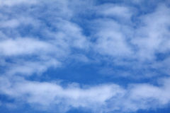 Wispy Clouds. White, wispy clouds against a bright blue sky Stock Photography