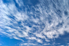 Wispy Clouds. High altitude winds create fast moving cloud designs Royalty Free Stock Image