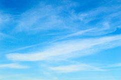 Wispy clouds against a beautiful blue sky Stock Images