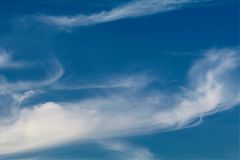 Wispy clouds Stock Images