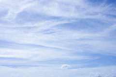 Wispy clouds on blue sky background. Soft wispy clouds streaming over a blue sky. Great for background Royalty Free Stock Photo