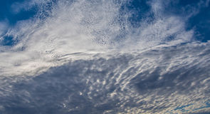 Wispy Clouds in the Blue Sky Stock Images