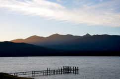 Wispy  clouds at dusk  over Lake Te Anau Royalty Free Stock Photo