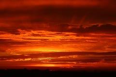 Wispy Cloudscape-Sonnenuntergang Lizenzfreie Stockfotos
