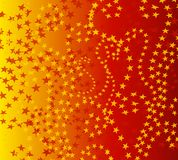 Wispy Red Gold Stars Pattern. A background pattern featuring colorful red and gold stars set against a gradient gold/red background Stock Images