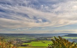 Wispy Sky. Landscape of rural France.Taken from a high view point , and showing wispy cloud formations Stock Image