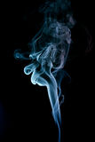 Wispy smoke. Macro view of colorful wispy smoke with black background Royalty Free Stock Images