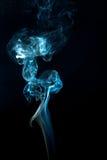 Wispy Smoke Pattern. Smooth and silky blue smoke pattern Royalty Free Stock Image