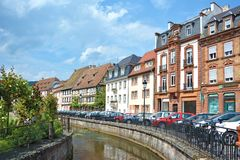 Small canal with beautiful traditional old European style houses in city center on sunny day royalty free stock photos