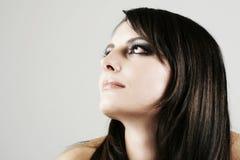 Wistful beautiful woman daydreaming Stock Photography