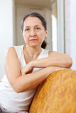 Wistful beauty mature woman in home Royalty Free Stock Images