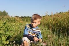 Wistful boy Stock Photos