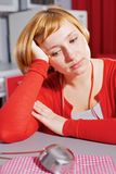 Wistful housewife in red royalty free stock images