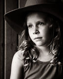 Wistful Little Girl in Cowboy Hat Stock Photos