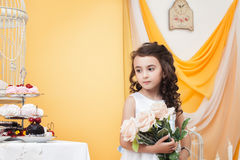 Wistful little lady posing with bouquet of roses Stock Photography