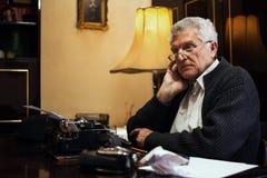 Wistful Retro Senior Man writer Royalty Free Stock Images