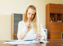 Wistful woman calculating something Stock Photos