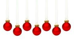 Wiszący czerwoni boże narodzenie ornamenty odizolowywający Fotografia Royalty Free