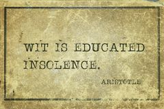 Wit is Aristotle. Wit is educated insolence - ancient Greek philosopher Aristotle quote printed on grunge vintage cardboard royalty free stock photo