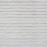 Wit geschilderd bakstenen muurfragment stock fotografie
