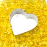 Wit hart dat door zalmolie wordt omringd Royalty-vrije Stock Fotografie