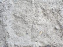 Wit met flarden van de ruwe textuur van de steenmuur voor achtergrond Royalty-vrije Stock Afbeelding