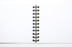 Wit notaboek dat op witte achtergrond wordt geïsoleerdc Stock Afbeeldingen