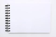 Wit notaboek dat op witte achtergrond wordt geïsoleerde Royalty-vrije Stock Foto