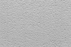 Wit pleister met hoge patronen en barsten - - kwaliteitstextuur/achtergrond stock fotografie