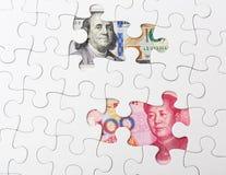 Wit raadsel met het Chinese bankbiljet van de V.S. en Royalty-vrije Stock Foto's
