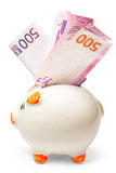 Wit spaarvarken dat met euro wordt gevuld Royalty-vrije Stock Fotografie