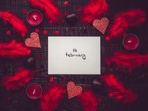 Witać nutowy z ręcznie pisany inskrypcji i menchii piórkami obrazy stock