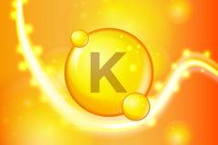 Witaminy K pigułki kapsuły złocista olśniewająca ikona Witamina kompleks z Chemiczną formułą połysku złoto błyska Medyczny i farm royalty ilustracja