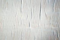 Witboek aan de muurclose-up die wordt gelijmd Royalty-vrije Stock Fotografie