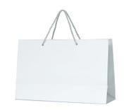 Witboek het winkelen zak op wit wordt geïsoleerd dat Royalty-vrije Stock Afbeeldingen