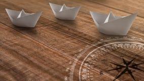 Witboekschepen op een houten rustieke achtergrond die tegen ??n richting op weg zijn royalty-vrije stock afbeelding