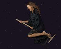 Witch. The witch flies on a mop at night stock images