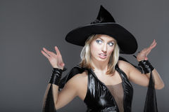Witch. The young woman in a suit of a witch Royalty Free Stock Photography