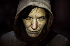 Witch!. Witch portrait with the hood and black background Stock Photo