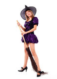 Witch. Pretty young blond woman dressed as a witch with a broom Stock Photos