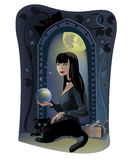 Witch. Dark headed beautiful young witch with black cat Stock Photos