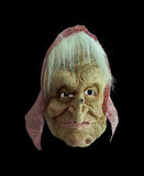 Witch. Worked Carnival and halloween mask of an old witch in a black background Royalty Free Stock Image