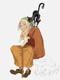 Witch. Old witch with a cat on his shoulder Stock Photos
